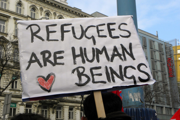 Schild refugees are human beeings